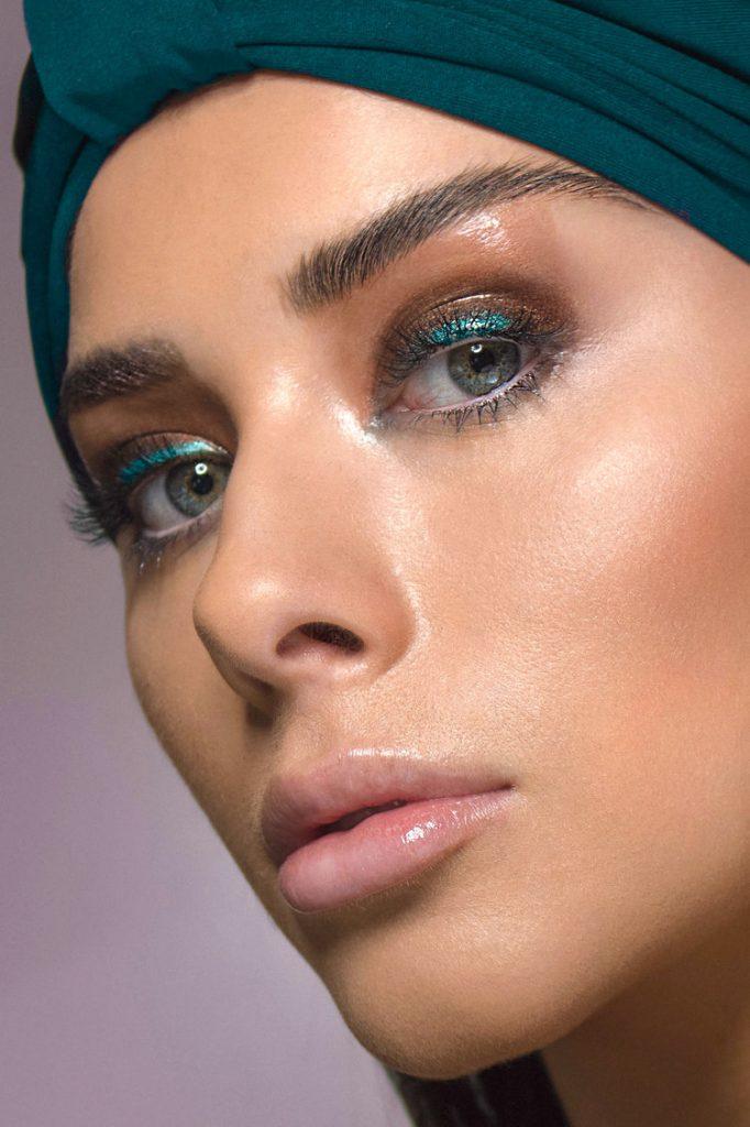 Eyelluminated by Katie Saarikko, model Alivia Celio wearing a teal turban with blue and brown eyeshadow.