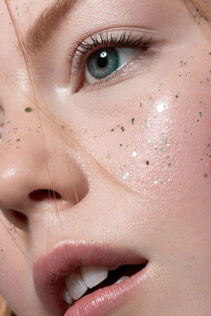 Alexandra Rayne of Devojka Models, close up with glitter freckles.