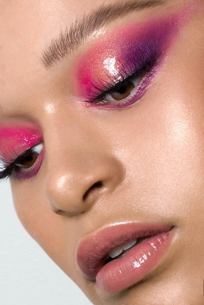 Baatile Praet of Devojka Models looking down with glossy pink and purple eyeshadow.